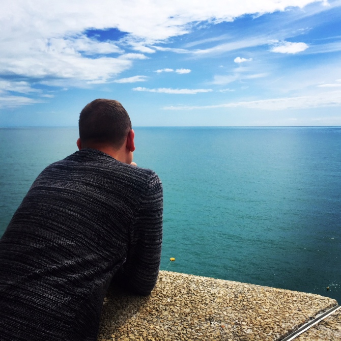 Mr Roams looking wistfully at the sea and wishing I wasn't taking photos of him